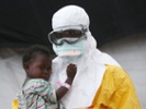 Liberian child with health care worker.