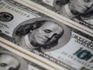 US dollar surges as Fed signals interest-rate hike