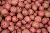 Red potatoes are offered for sale at Eas