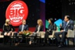 Rick Caruso speaking with panelists at Retails BIG Show