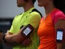 Smartphones displaying fitness data