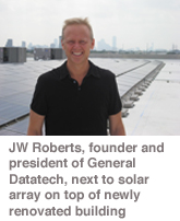 JW Roberts, founder and president of General Datatech, next to solar array on top of newly renovated building