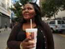 Woman drinking a soda