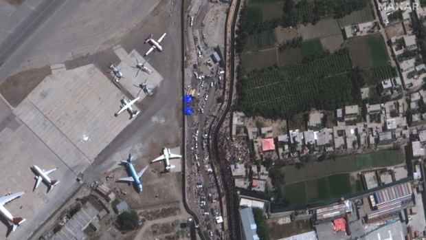 Satellite images show crowds at Kabul airport before two reported explosions