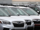 Report: US auto sales ease as dealer profits look up