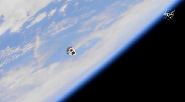 SpaceX's Dragon cargo ship docks at space station in time for astronaut's birthday