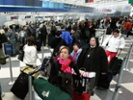 Tensions brew at airports, as TSA caps overtime