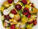 Corn salad with summer fruits and vegetables