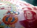 China's yuan falls below one-year low; dollar declines