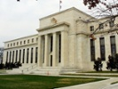 Economists: Rising inflation might prompt Fed to rethink rate cuts