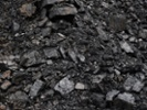 Utah regulators want coal company's surety bond to clean coal-paved lot