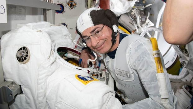 Astronaut says pinched nerve is why NASA called off space station spacewalk