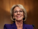 Officials urge DeVos to stop student-loan deal